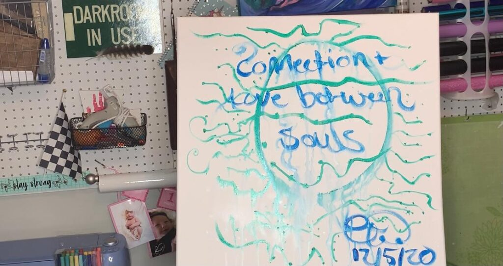 """""""connection and love between souls"""" written under the paint"""